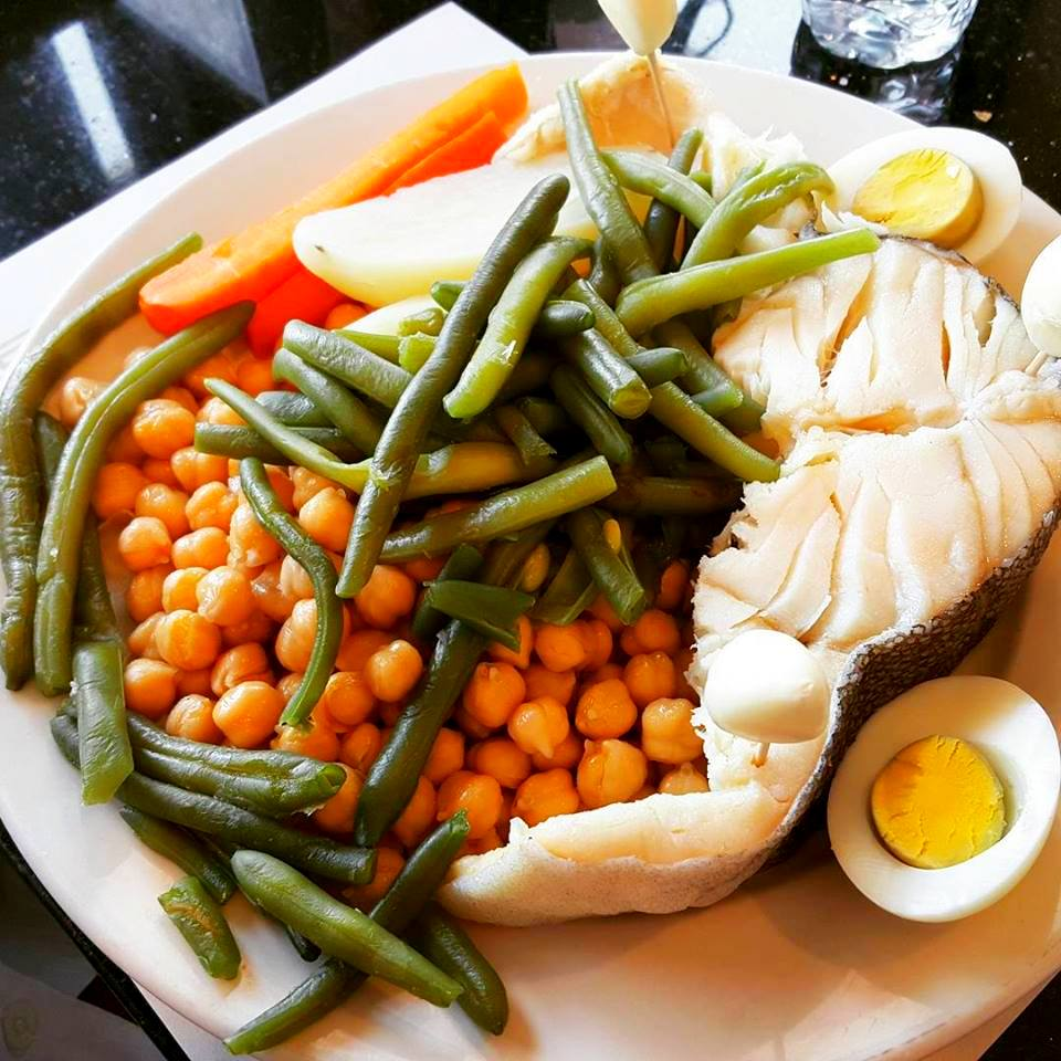 Boiled cod fish with vegetables